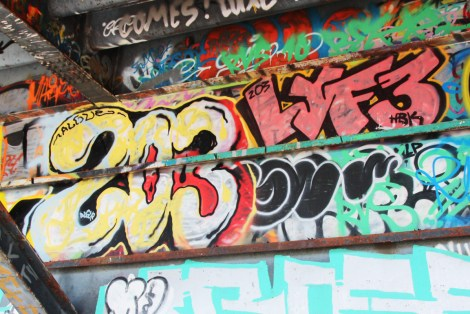 Throws by Algue representing the 203 crew (left) and Lyfer (top right) under a bridge