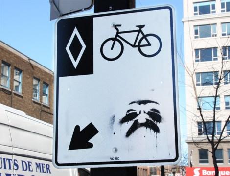 Jester stencil over traffic sign