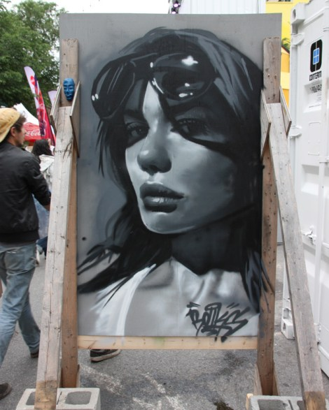 Rouks on the reverse of Naimo's board for the 2016 edition of Mural Festival; small sculpted face on the frame is by Biko