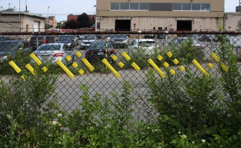 tape tagging on fence by Ygrek