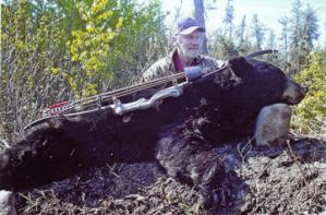 Larry Stewart bags a black bear.