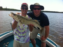 Matt and Tim with a huge Lac Seul walleye