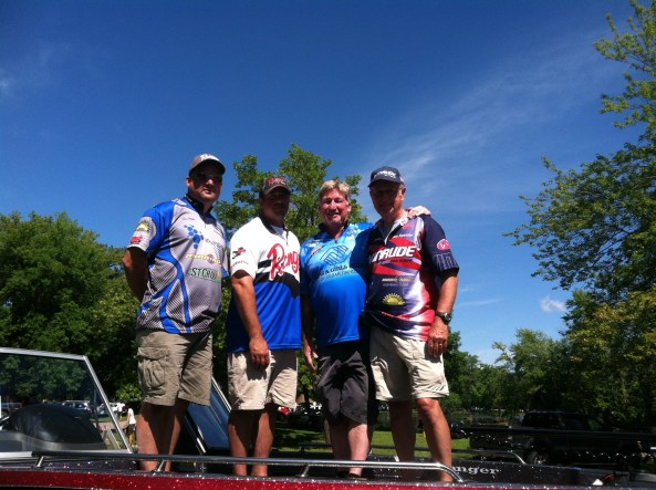 Steve, Mike, and Spike with Dave Nichols, event director, on the bow of Mike's Ranger!