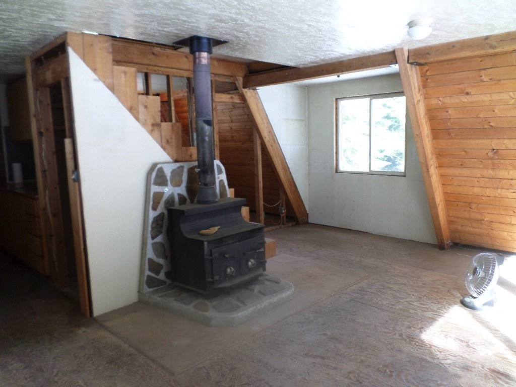 The wood stove is the only source of heat. It is a warm one.