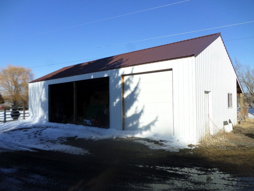 Recently constructed pole barn shop with a lean too on the back side.
