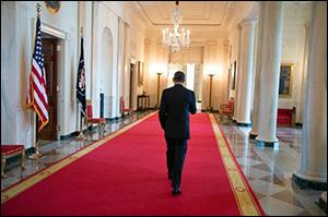 President Obama Walking in Cross Hall at the White House. (Official White House Photo by Pete Souza.)