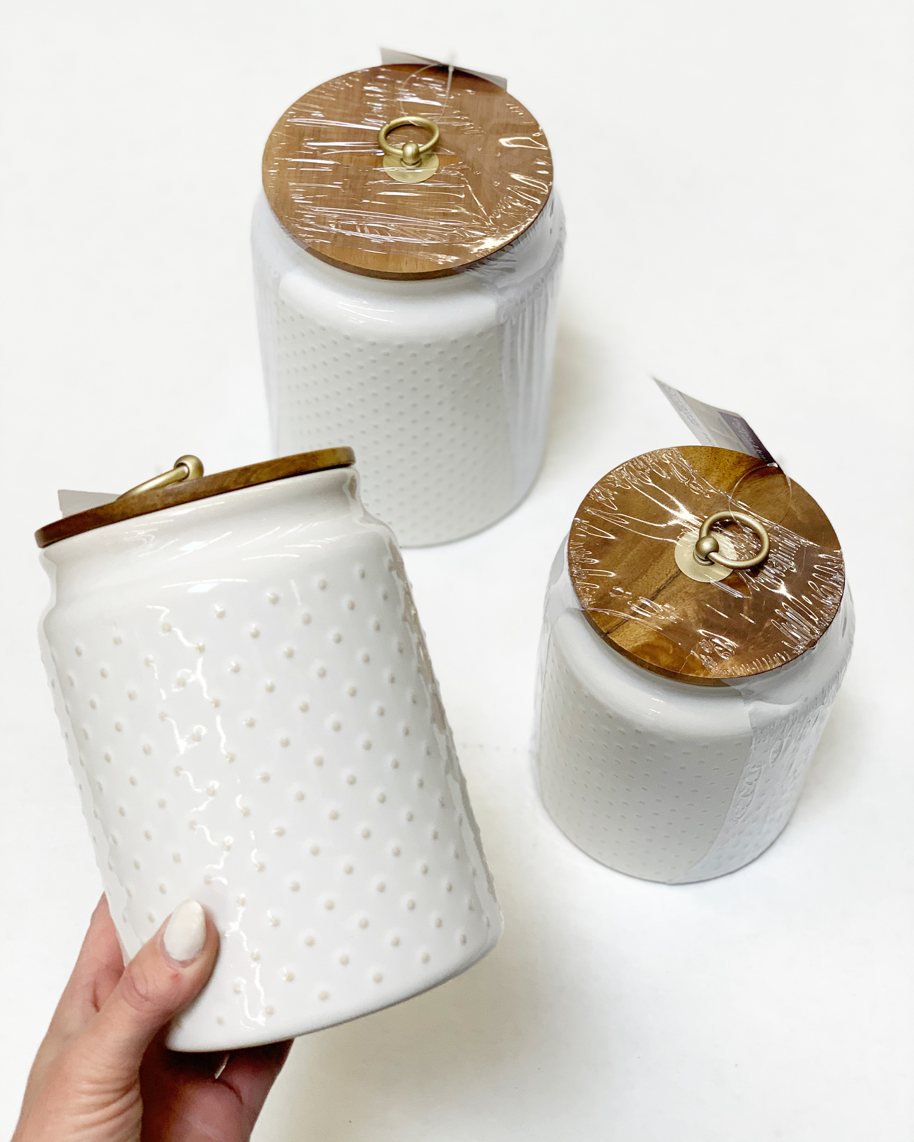 white hobnail canister with wooden lids