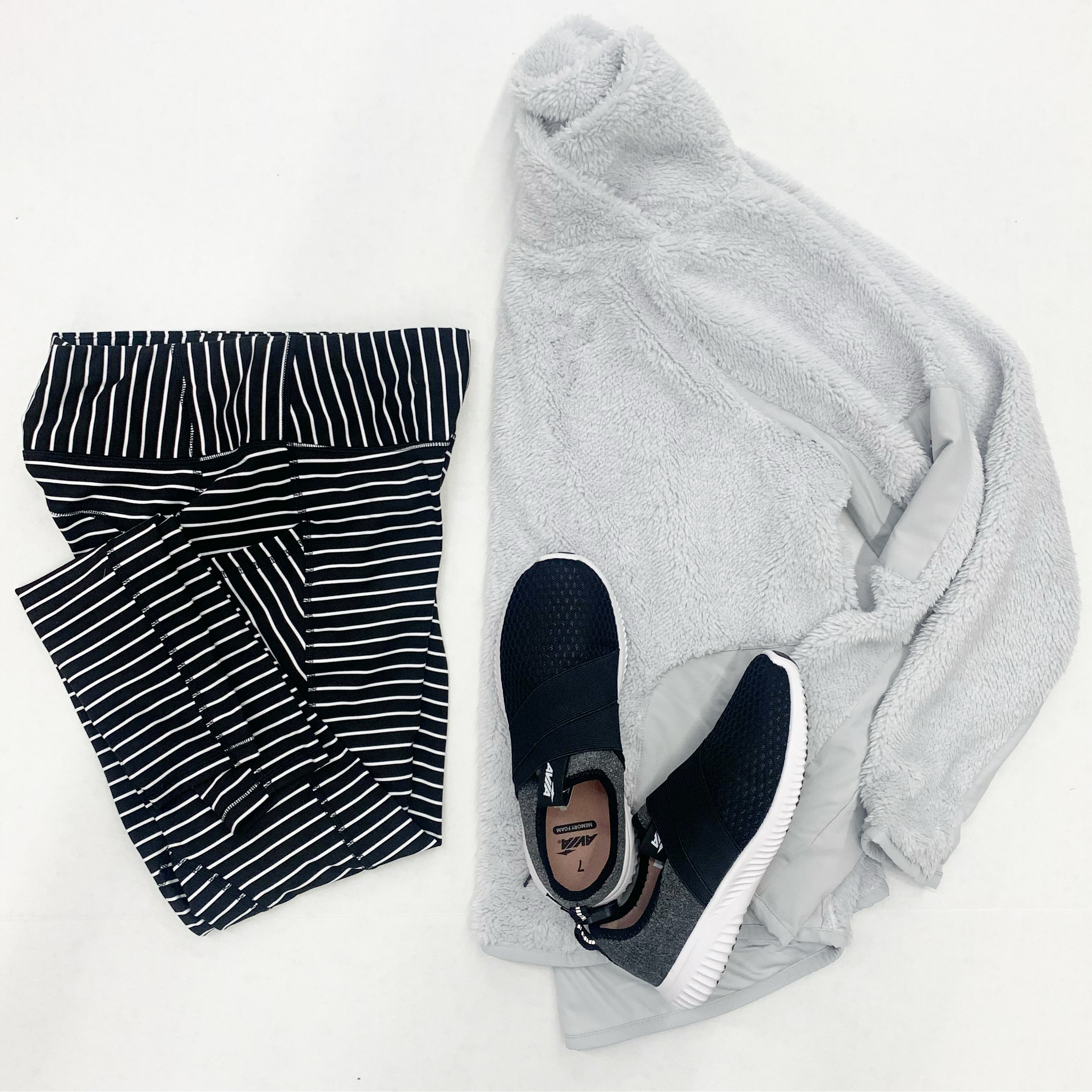 black and white striped lulu dupes with grey sherpa pullover and athletic shoe