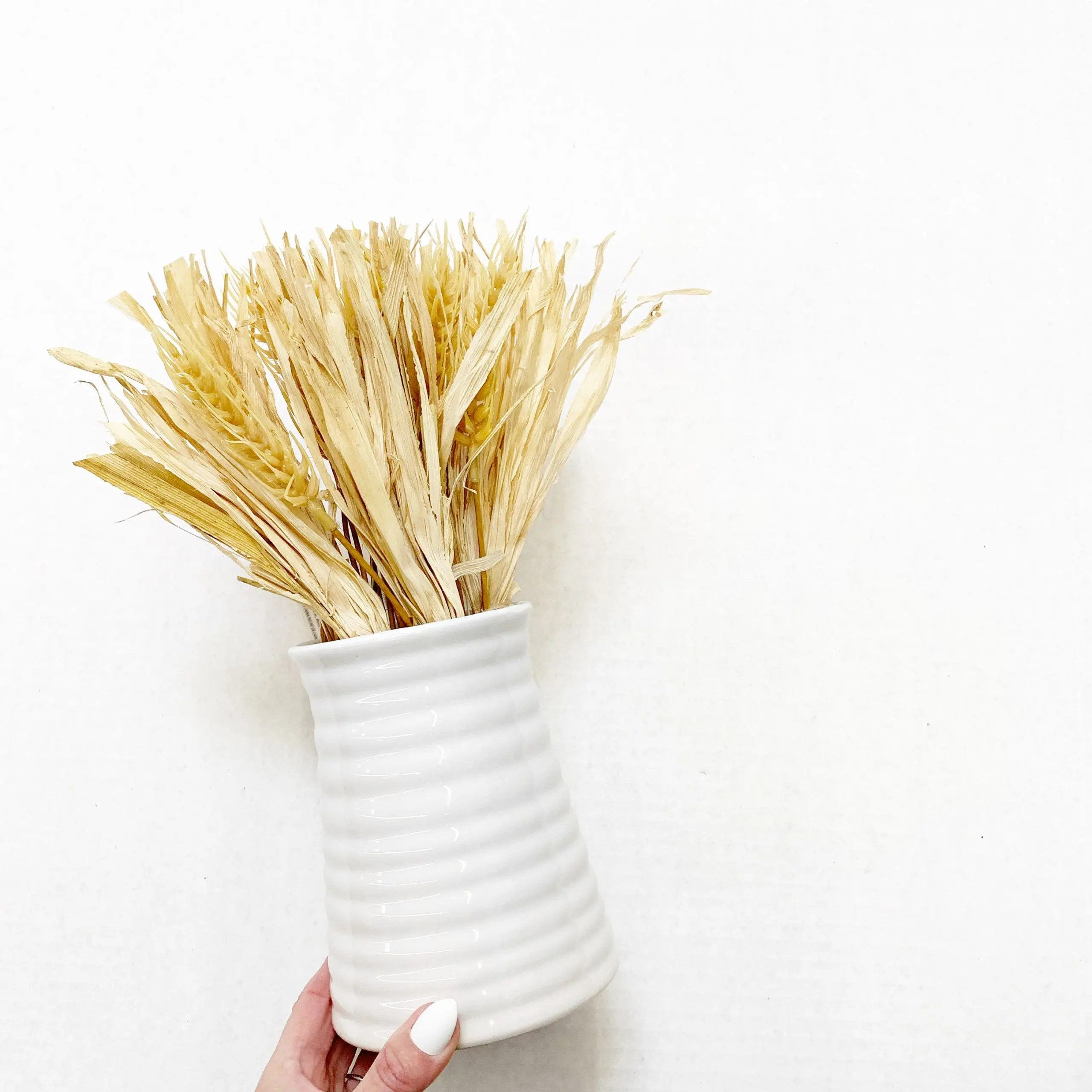 harvest wheat bouquet in white ceramic pot