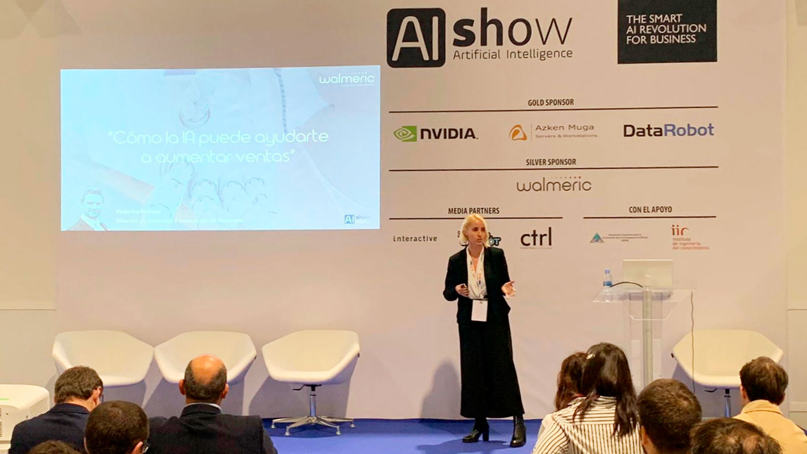 Irene Medina, Marketing Directo at Walmeric, giving a talk in AIshow
