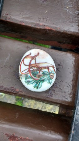 painted stones on seats at earnse bay (3) - copy