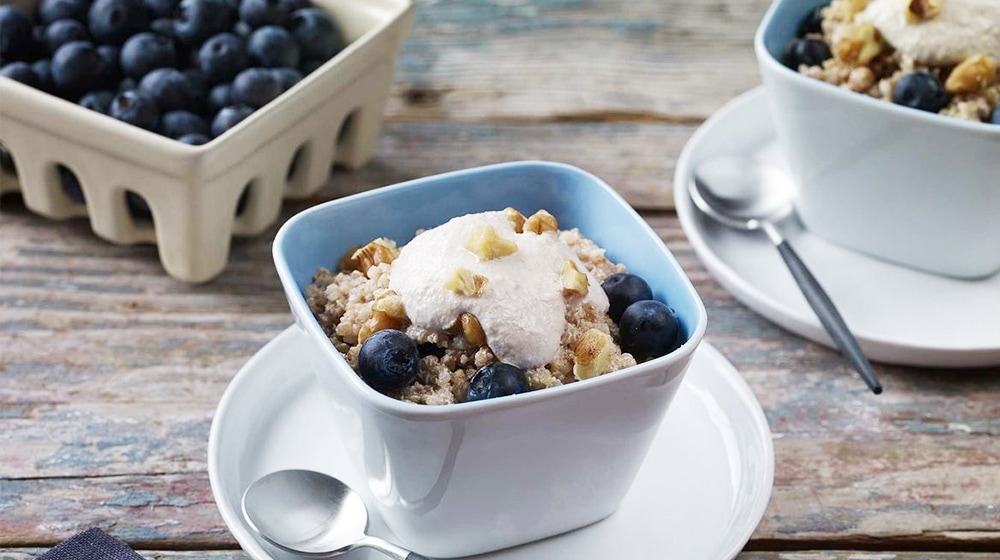 Breakfast Quinoa with Walnut Cream and Blueberries