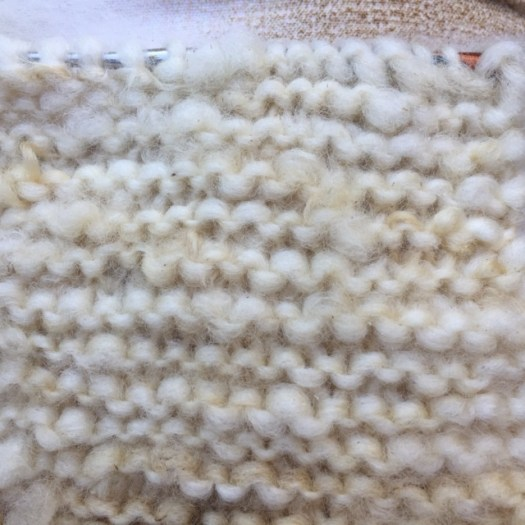Close-up of a project knit with unspun yarn