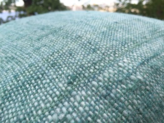 Close-up of a hand woven pillow case