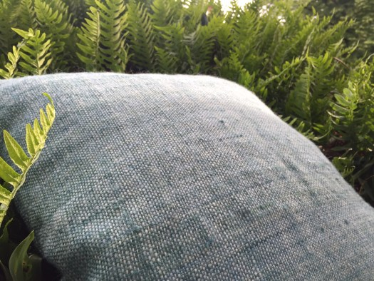 A hand woven pillowcase in the fern