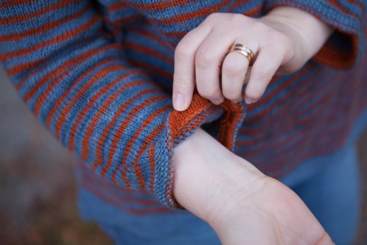 A detail of the sleeve of a knitted sweater