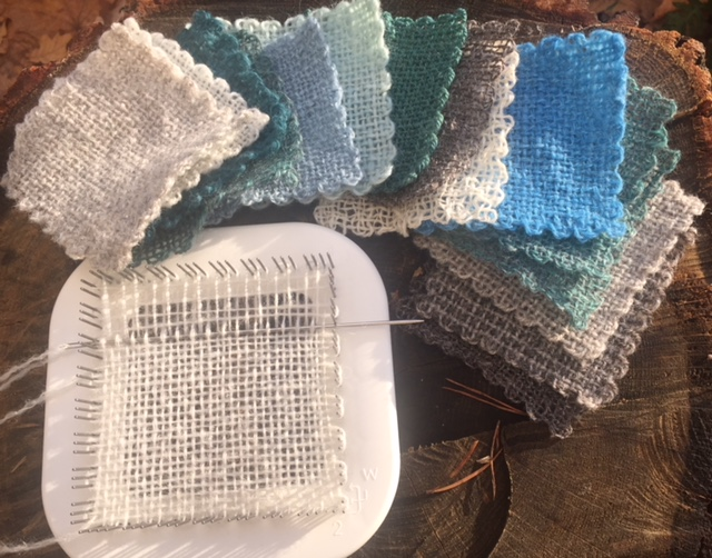 a small loom and lots of finished woven squares
