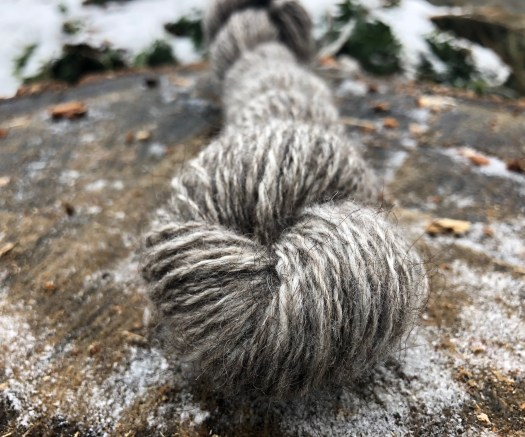A skein of grey handspun yarn