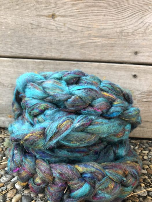 A braid of turquoise based sari silk