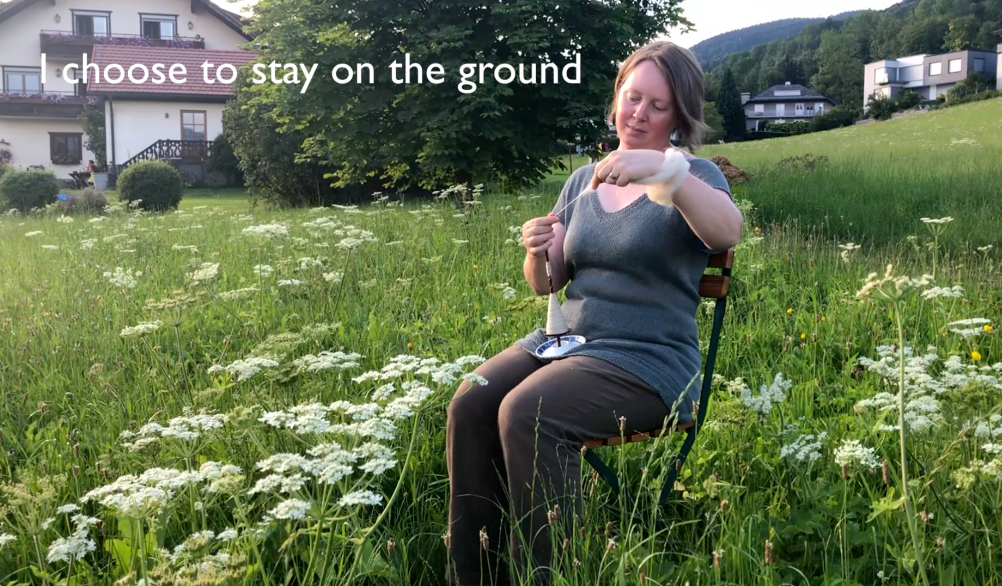 Josefin Waltin spinning on a chair on a meadow. Text says I choose to stay on the ground
