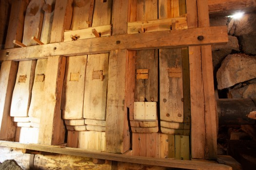 Wooden stocks in a fulling mill.