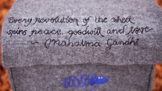 A quote embroidered on a felted material