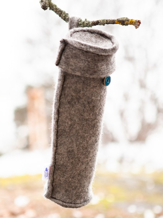 A woolen tube hanging on a branch.