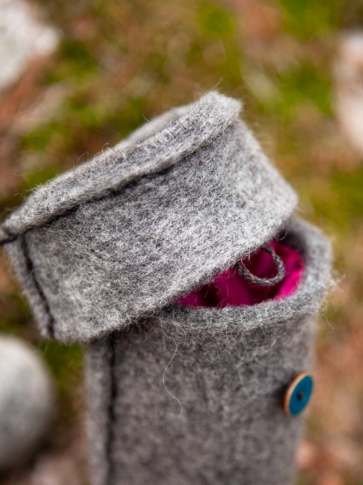 Close-up of a woolen tube with a lid