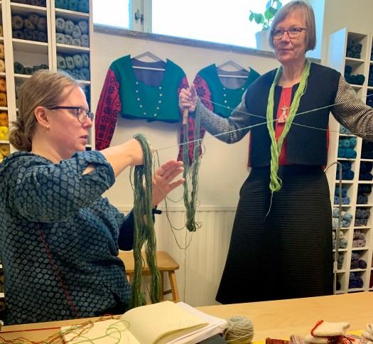 Untangling yarn in Karin Kahnlund's studio.