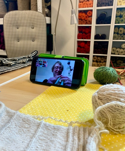 A knitting course with physical and digital participants.