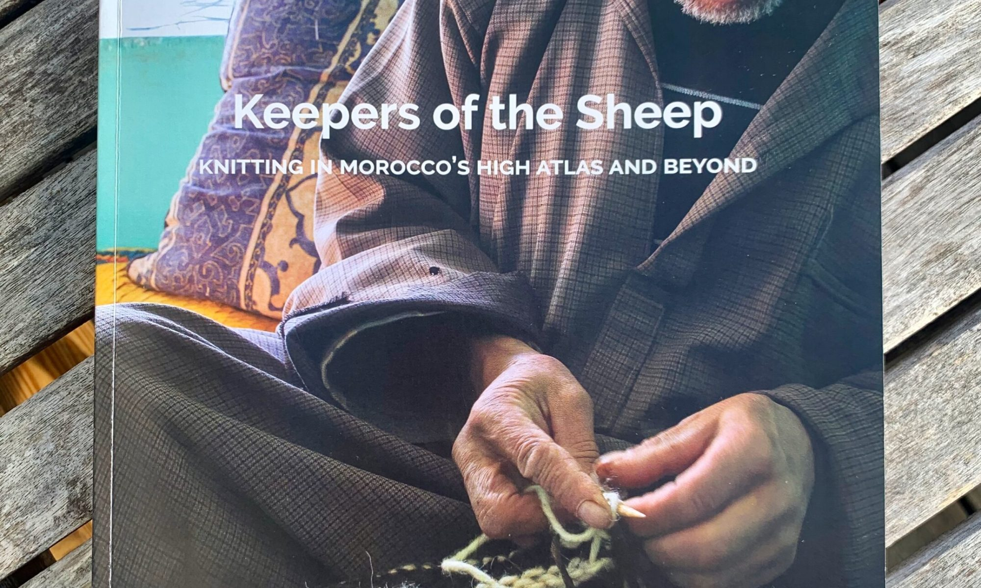 Keepers of the sheep – knitting Morocco's High Atlas and beyond, by Irene Waggener with Muah Ahansali, Hussein Mardi, Muah n'Ait Tabatoot and Noura Eddylymy. Photo published with permission from the author.