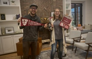 Student workers Josh Guenther and Kaitlyn Arrow pose with some Eastern gear.