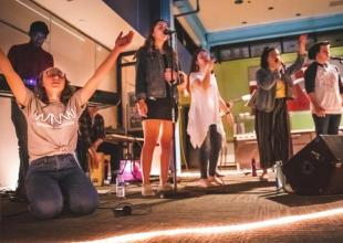 Wednesday Night Worship takes place at Olson field. Worship teams sing praises to God and feature a speaker. For this collaboration, students were able to experience the different types of Eastern's worship come together.