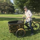 Intern Luke Myers with Pollinator Bike Cart