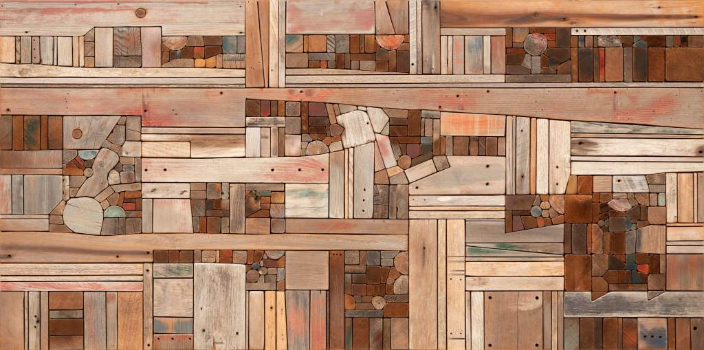 """An image of Morrison's """"Wood Collage: Landscape,"""" which includes pieces of driftwood of various colors, sizes, and shapes placed together into a single frame."""