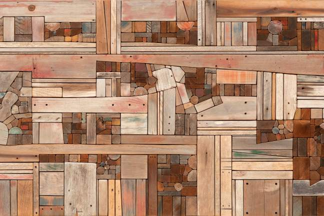 "An image of Morrison's ""Wood Collage: Landscape,"" which includes pieces of driftwood of various colors, sizes, and shapes placed together into a single frame."