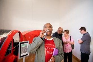 Melvin Giles, Program Director at The StoryMobile, blows his bubbles in front of the StoryMobile bike.