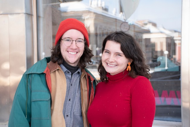 "(Left to right) Joe Price and Olivia Schumack pose for a picture outside of the WAM Shop. Schumack wears the Stone Arch ""Claymate"" earrings."