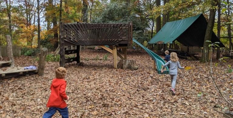 Acorn Hill Waldorf Kindergarten and Nursery preschoolers running outdoors toward a large tent