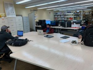 Students siting in designated seats and are 6ft apart while working.