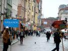 Toruń rainy street scene.