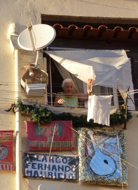A fado lover in the Mouraria has loudspeakers and fan signs high up outside her fifth story window.