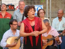 Luísa Soares sings to our group and local residents who have poured into historic Largo da Severa square.