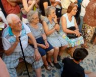 Locals enjoy the passing fado show.