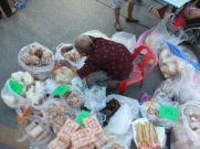A woman puts out her wares at the Saturday Walking Street Market.