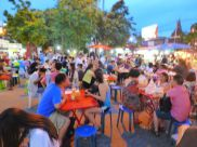 An al fresco crowd at the Saturday night food market.