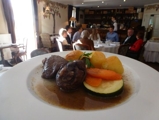 I jump up to photograph a quail dish and then coq au vin.