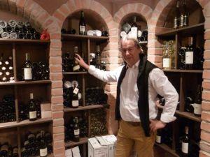 Pawła Gąsiorka in his wine cellar.