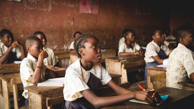 black students in primitive school setting