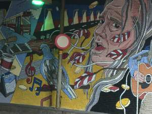 Straatmuzikant Chuck Deely in tramtunnel bij Centraal Station